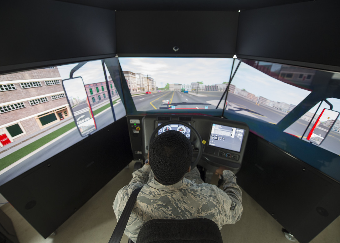 U.S. Air Force Staff Sgt. John Williams, 86th Vehicle Readiness Squadron assistant noncommissioned officer in charge of equipment support, operates the 86th VRS's new vehicle simulator at Ramstein Air Base, Germany, Aug 7, 2019. The simulator trains Airmen on a variety of vehicles and situations. (U.S. Air Force photo by Staff Sgt. Kirby Turbak)