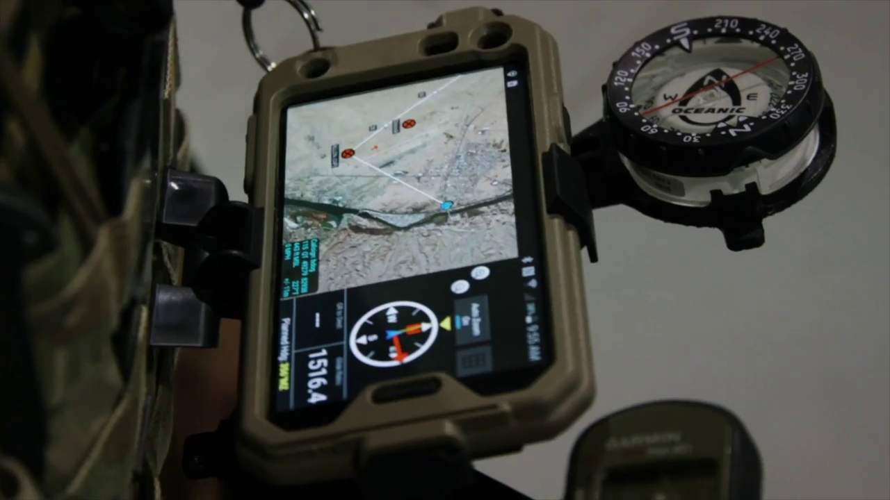 A soldier uses ATAK on a mounted mobile device
