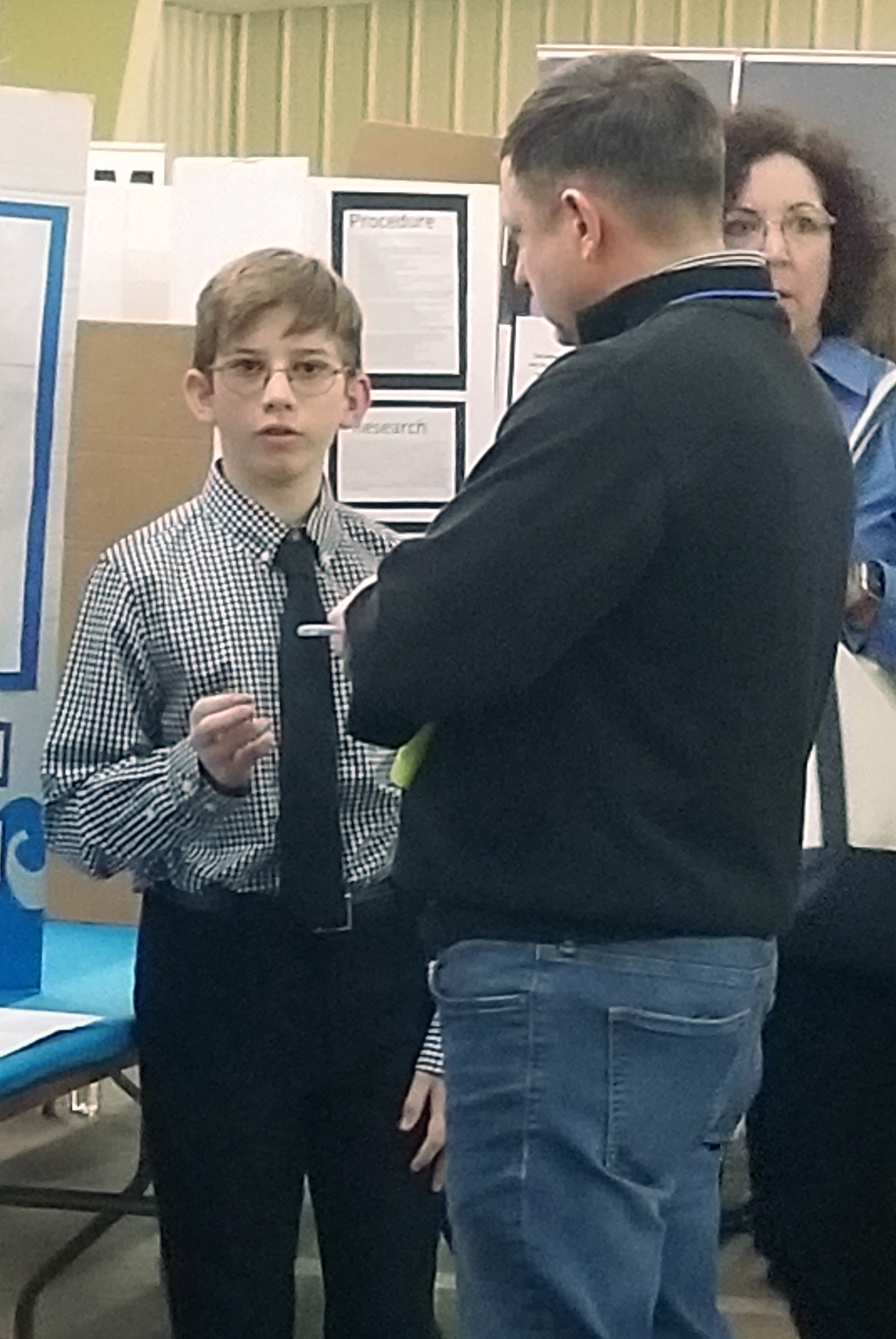 A student presents his project to Keith Williams